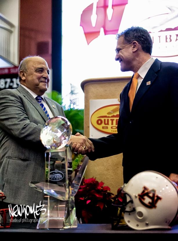 University of Wisconsin's Coach Barry Alvarez and Auburn University's Coach Gus Malzahn.