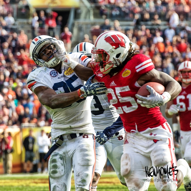 Wisconsin's Melvin Gordon and Auburn's Joseph Turner battle it out on the way to the end zone.