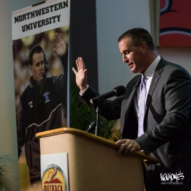 NW Coach Pat Fitzgerald high fiving himself.